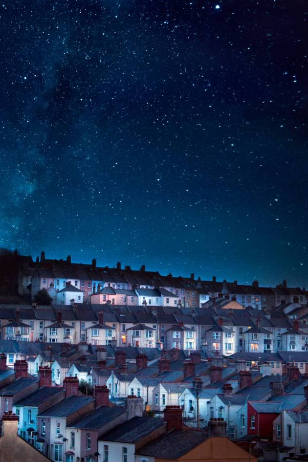 photo of houses under starry skies